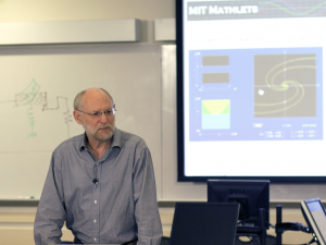 Photo of Haynes Miller lecturing with Mathlet in background